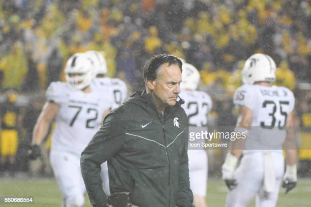Michigan State Spartans head coach Mark Dantonio walks back to the sidelines during the rain storm during the Michigan Wolverines versus Michigan...