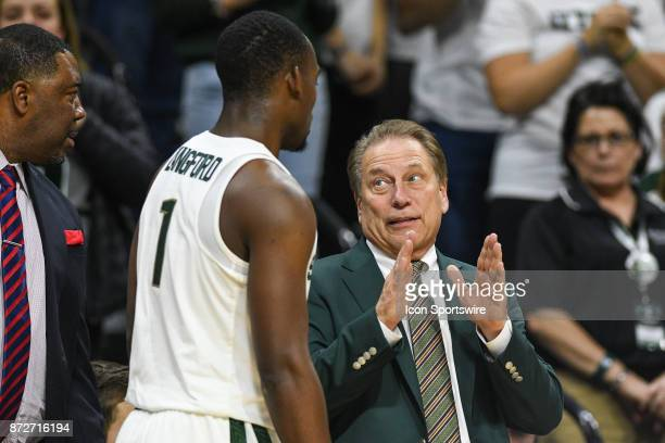 Michigan State Spartans head coach Tom Izzo chats with guard Joshua Langford during a college basketball game between Michigan State and North...