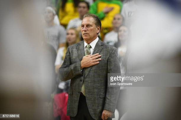 Michigan State Spartans head coach Tom Izzo stands for the national anthem during an exhibition college basketball game between Michigan State and...