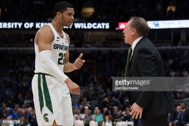 Michigan State Spartans head coach Tom Izzo talks to Michigan State Spartans guard Miles Bridges during the State Farm Champions Classic basketball...