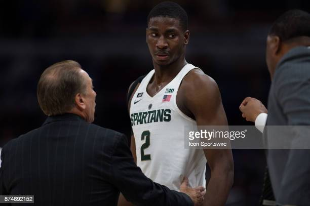 Michigan State Spartans head coach Tom Izzo talks to Michigan State Spartans forward Jaren Jackson Jr on the sidelines during the State Farm...
