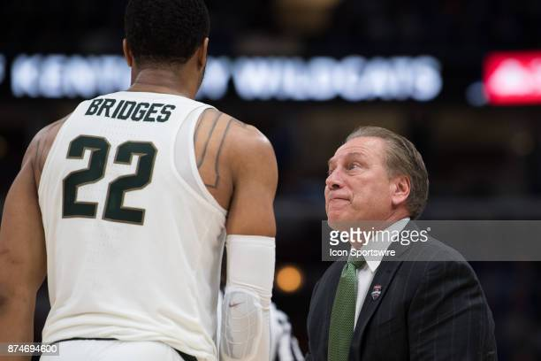 Michigan State Spartans head coach Tom Izzo talks to Michigan State Spartans guard Miles Bridges on the sidelines during the State Farm Champions...