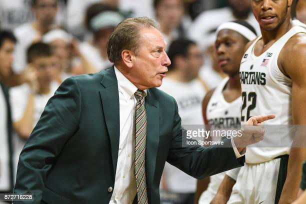 Michigan State Spartans head coach Tom Izzo talks to one of his Spartan players during a college basketball game between Michigan State and North...