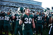 Michigan State Spartans players celebrate after the game against the Maryland Terrapins at Spartan Stadium on November 14 2015 in East Lansing...