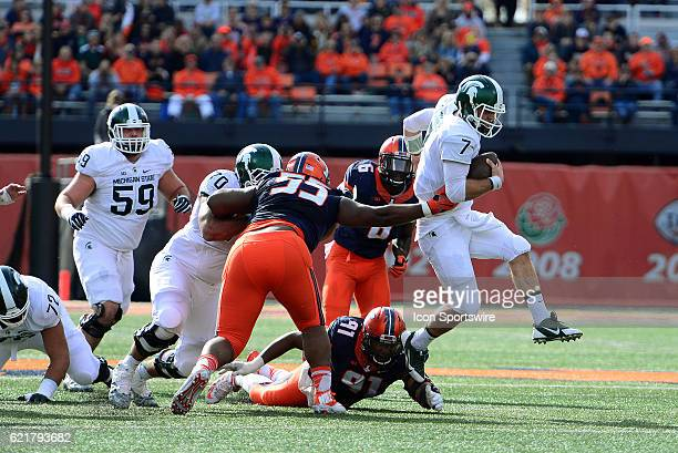 Michigan State Spartans Quarterback Tyler O'Connor escapes the tackle of Illinois Fighting Illini Defensive Lineman Dawuane Smoot Illinois Fighting...