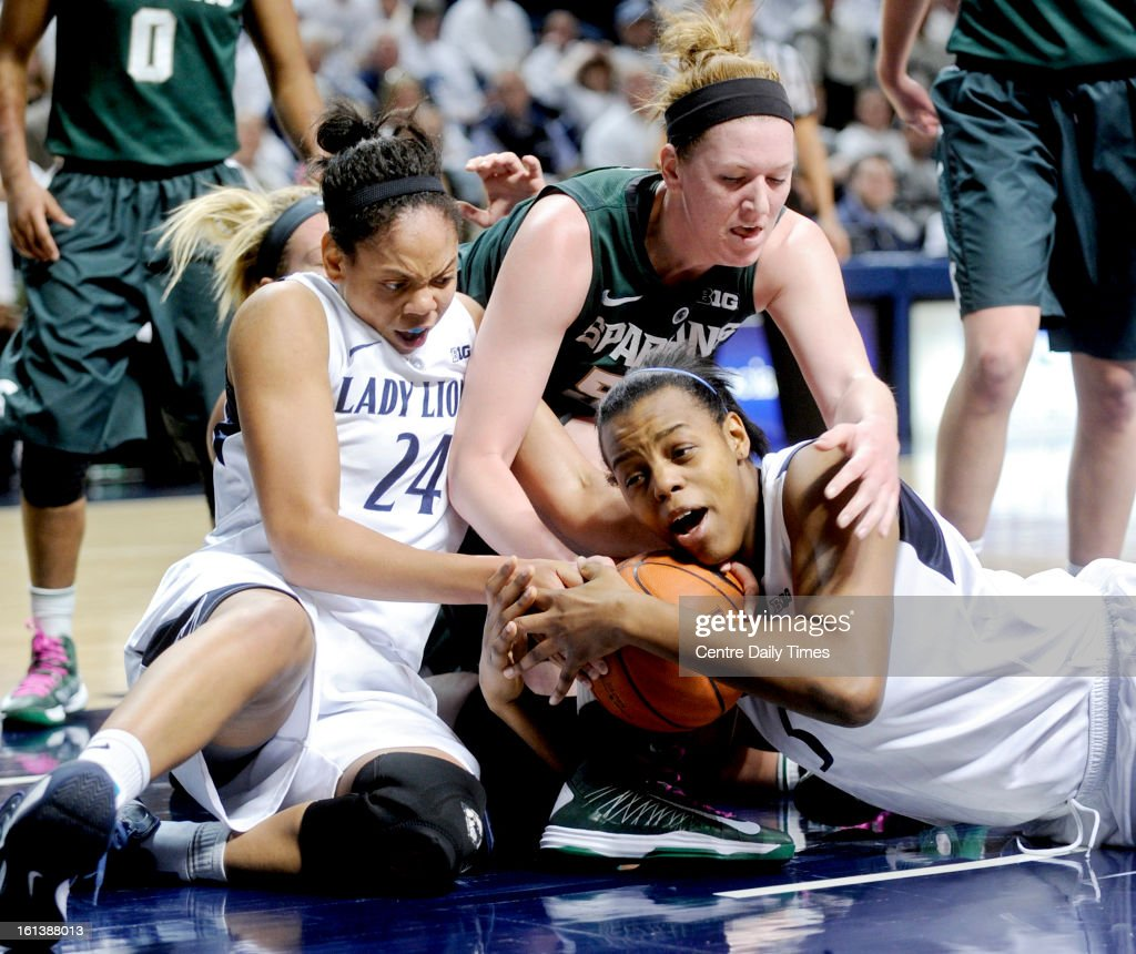 Michigan State's Becca Mills tries to steal the ball from Penn State's Talia East at the Bryce Jordan Center in State College, Pennsylvania, February 10, 2013. The Lady Lions won, 71-56.