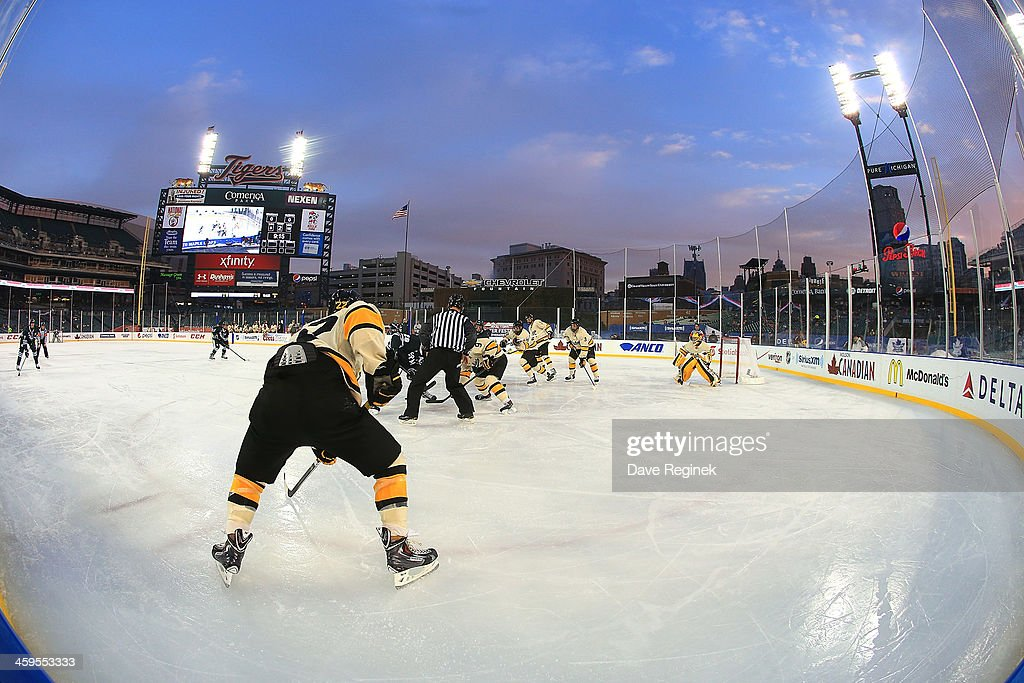 Michigan Tech Huskies and the Michigan State Spartans face-off during game one of the Hockeytown Winter Festival Great Lakes Invitational - Day 1 played outdoors at Comerica Park on December 27, 2013 in Detroit, Michigan. The Huskies won in a shoot-out 3-2