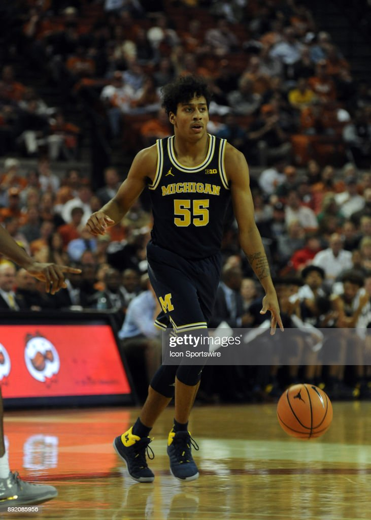 Michigan Wolverine guard Eli Brooks dribbles down court during 59 - 52 win over the Texas Longhorns on December 12, 2017 at the Frank Erwin Center in Austin, TX.