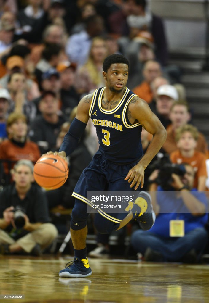 Michigan Wolverine guard Zavier Simpson drives down court during 59 - 52 win over the Texas Longhorns on December 12, 2017 at the Frank Erwin Center in Austin, TX.
