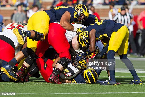Michigan Wolverines defensive end Chris Wormley and Michigan Wolverines safety Dymonte Thomas assist in a tackle during game action between the...