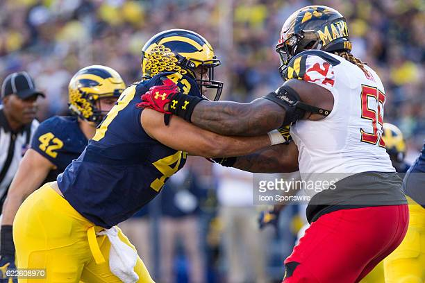 Michigan Wolverines defensive end Chris Wormley fights off a block by Maryland Terrapins offensive lineman Derwin Gray during game action between the...