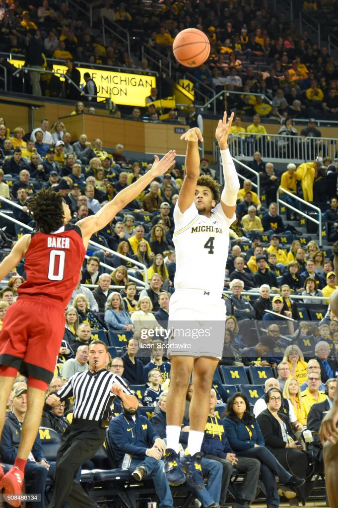 Michigan Wolverines forward Isaiah Livers (4) shoots from three point range during the Michigan Wolverines game versus the Rutgers Scarlet Knights on Sunday January 21, 2018 at Crisler Center Field in Ann Arbor, MI.