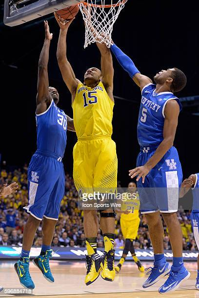 Michigan Wolverines forward Jon Horford battles with Kentucky Wildcats forward Julius Randle and Kentucky Wildcats guard Andrew Harrison in action...
