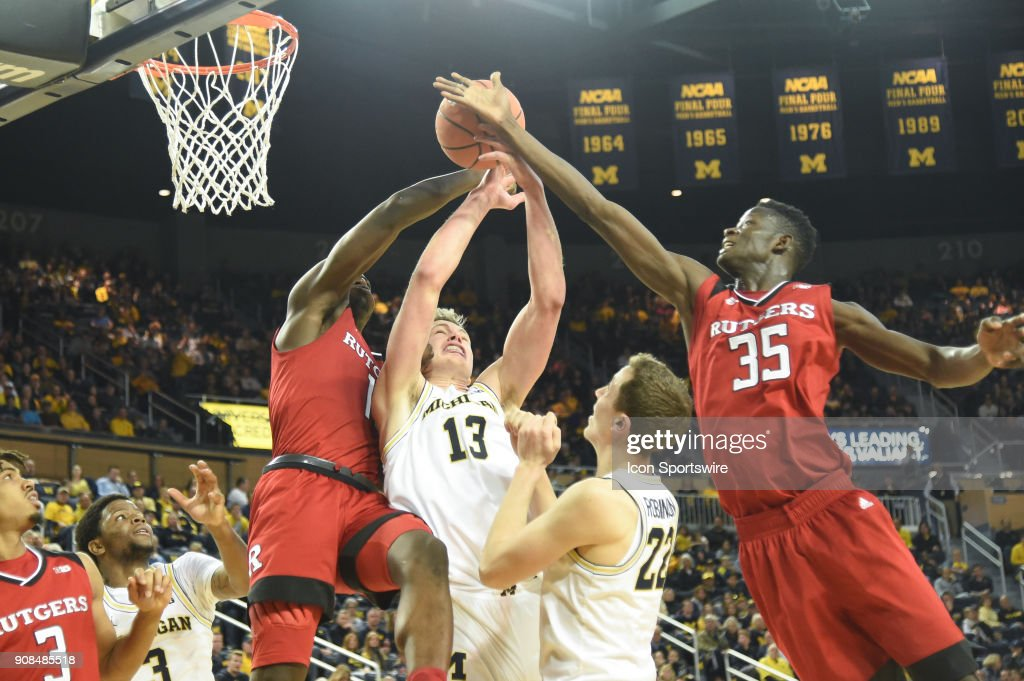 Michigan Wolverines forward Moritz Wagner (13) fights for this rebound with Rutgers Scarlet Knights forward Eugene Omoruyi (11) and Rutgers Scarlet Knights guard Issa Thiam (35) during the Michigan Wolverines game versus the Rutgers Scarlet Knights on Sunday January 21, 2018 at Crisler Center Field in Ann Arbor, MI.