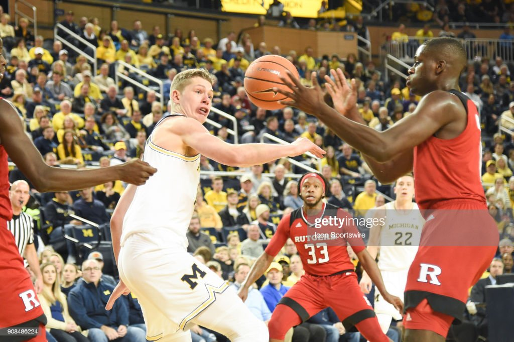Michigan Wolverines forward Moritz Wagner (13) loses the ball to Rutgers Scarlet Knights guard Geo Baker (0) during the Michigan Wolverines game versus the Rutgers Scarlet Knights on Sunday January 21, 2018 at Crisler Center Field in Ann Arbor, MI.
