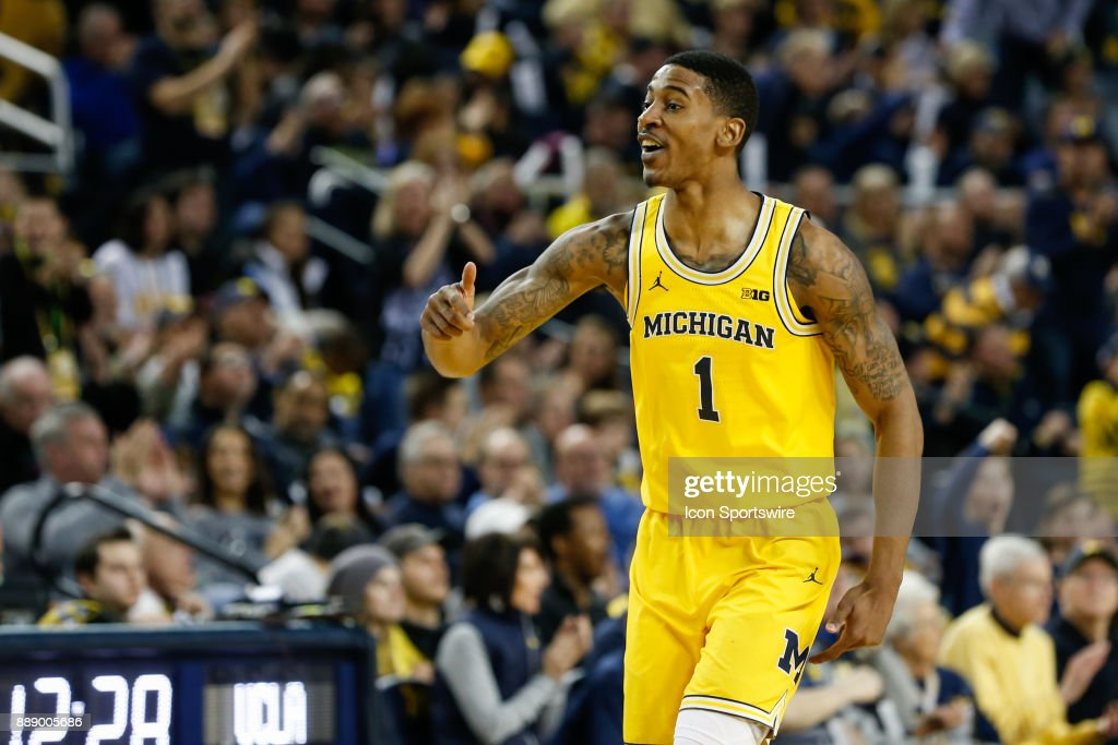 Michigan Wolverines guard Charles Matthews (1) celebrates an offensive play during the second half of a regular season non-conference basketball game between the UCLA Bruins and the Michigan Wolverines on December 9, 2017 at the Crisler Center in Ann Arbor, Michigan. Michigan defeated UCLA 78-69 in overtime.