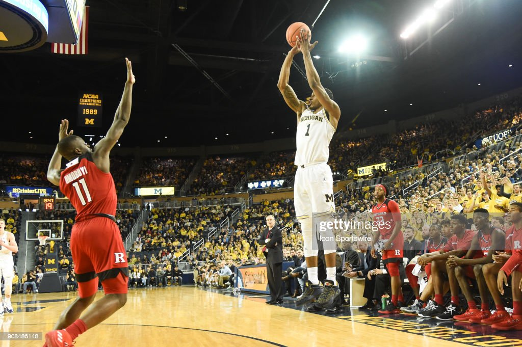 Michigan Wolverines guard Charles Matthews (1) hits a three point shot during the Michigan Wolverines game versus the Rutgers Scarlet Knights on Sunday January 21, 2018 at Crisler Center Field in Ann Arbor, MI.