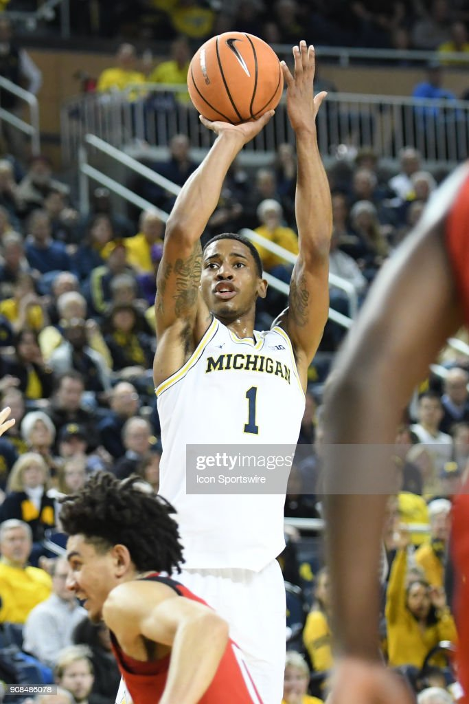 Michigan Wolverines guard Charles Matthews (1) shoots from outside the arc during the Michigan Wolverines game versus the Rutgers Scarlet Knights on Sunday January 21, 2018 at Crisler Center Field in Ann Arbor, MI.