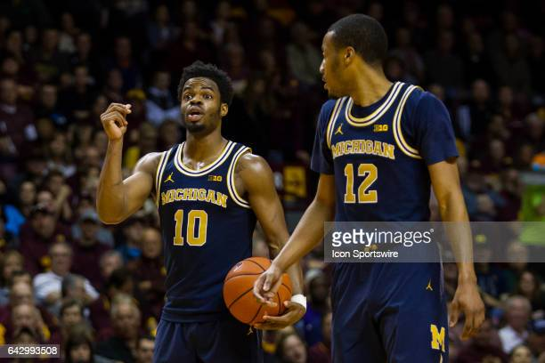 Michigan Wolverines guard Derrick Walton Jr calls a play during the Big Ten Conference game between the Michigan Wolverines and the Minnesota Golden...