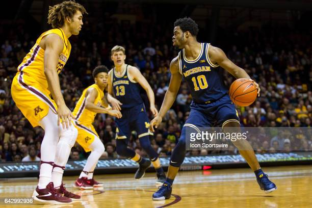 Michigan Wolverines guard Derrick Walton Jr in action during the Big Ten Conference game between the Michigan Wolverines and the Minnesota Golden...