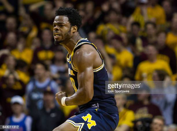Michigan Wolverines guard Derrick Walton Jr reacts after forward DJ Wilson scored the game tying 3 pointer during the Big Ten Conference game between...