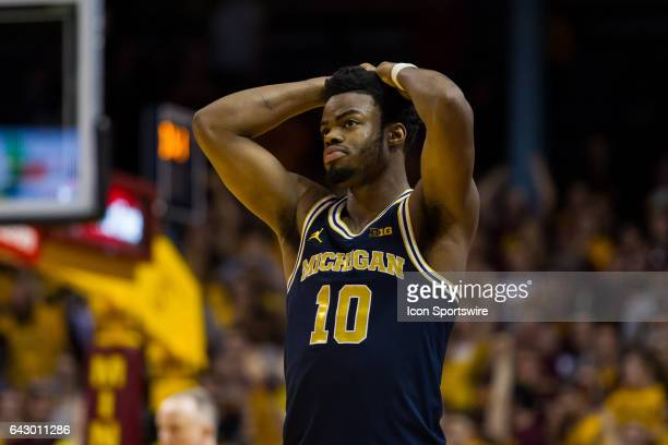 Michigan Wolverines guard Derrick Walton Jr reacts after missing a game tying 3 pointer during the Big Ten Conference game between the Michigan...