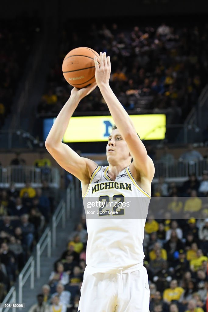 Michigan Wolverines guard Duncan Robinson (22) shoots from three point range during the Michigan Wolverines game versus the Rutgers Scarlet Knights on Sunday January 21, 2018 at Crisler Center Field in Ann Arbor, MI.