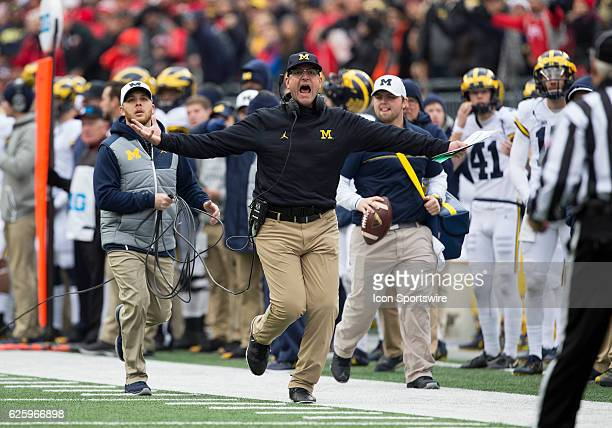 Michigan Wolverines head coach Jim Harbaugh does not agree with the call by the officials during an NCAA football game between the Michigan...