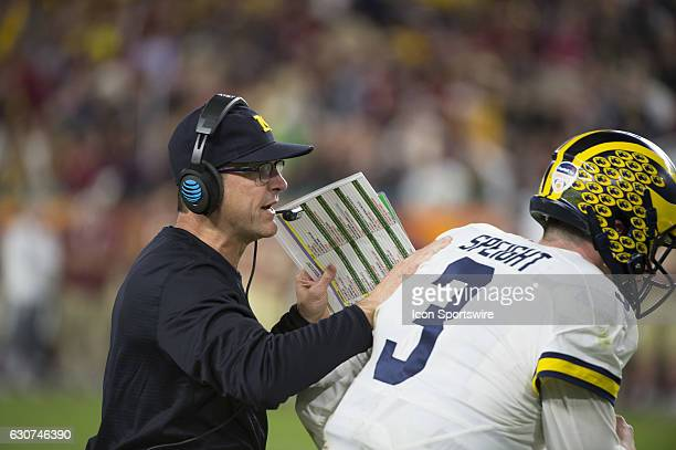 Michigan Wolverines Head Coach Jim Harbaugh sends Michigan Wolverines Quarterback Wilton Speight back on the field with a play during the NCAA...