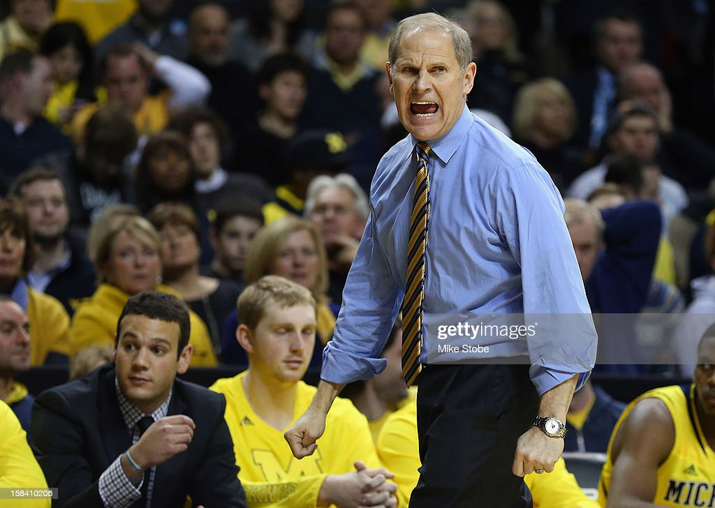 Michigan Wolverines head coach <a gi-track='captionPersonalityLinkClicked' href=/galleries/search?phrase=John+Beilein&family=editorial&specificpeople=233435 ng-click='$event.stopPropagation()'>John Beilein</a> calls out from the bench against West Virginia Mountaineers during the Brooklyn Hoops Winter Festival on December 15, 2012 at Barclays Center in the Brooklyn borough of New York City. Michigan Wolverines defeated West Virginia Mountaineers 81-66.