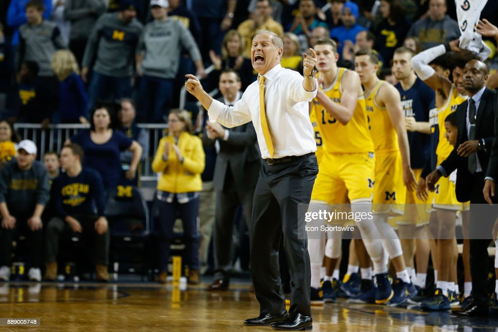 Michigan Wolverines head coach John Beilein shouts instructions to his players during the second half of a regular season non-conference basketball game between the UCLA Bruins and the Michigan Wolverines on December 9, 2017 at the Crisler Center in Ann Arbor, Michigan. Michigan defeated UCLA 78-69 in overtime.