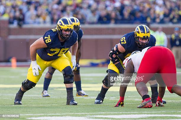 Michigan Wolverines offensive lineman Erik Magnuson and offensive lineman Kyle Kalis wait for the ball to be snapped during game action between the...