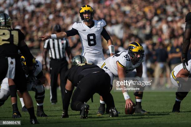 Michigan Wolverines quarterback John O'Korn looks at the play clock during the college football game between the Purdue Boilermakers and Michigan...