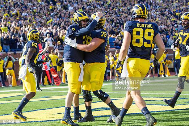 Michigan Wolverines quarterback Wilton Speight is congratulated by Michigan Wolverines offensive lineman Erik Magnuson after scoring a touchdown...