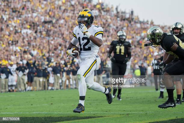 Michigan Wolverines running back Chris Evans scores a touchdown on a 10yard run during the college football game between the Purdue Boilermakers and...
