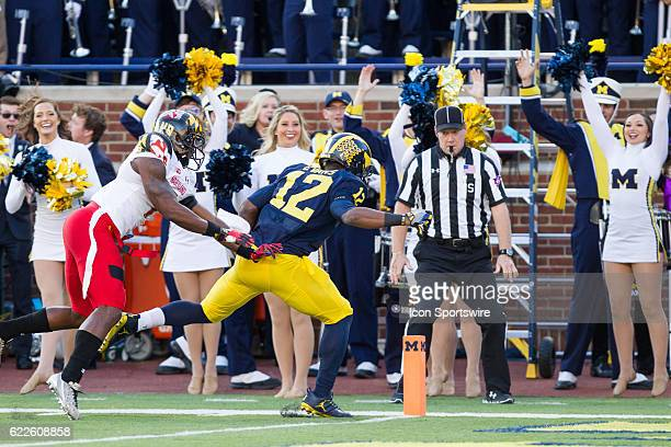 Michigan Wolverines running back Chris Evans tries to cross the plane of the goal line before being pushed outofbounds by Maryland Terrapins...