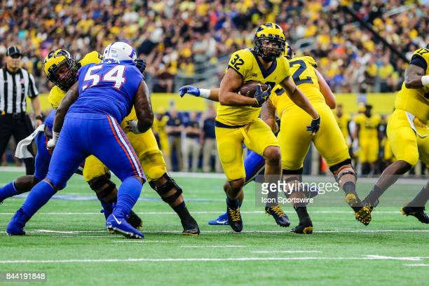 Michigan Wolverines running back Ty Isaac runs through the line of scrimmage during the game between the Michigan Wolverines and the Florida Gators...