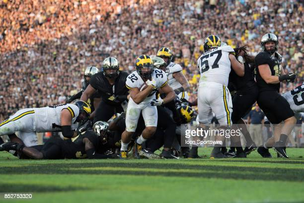 Michigan Wolverines running back Ty Isaac scores a touchdown on a 1yard run during the college football game between the Purdue Boilermakers and...