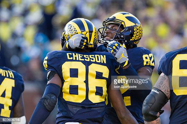 Michigan Wolverines wide receiver Jehu Chesson receives congratulations from teammate wide receiver Amara Darboh after scoring a touchdown during...