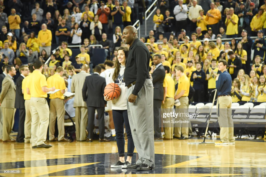Michigan Wolverines Women's player Katelynn Flaherty stands with former Michigan Wolverines men's great Glen Rice as Flaherty is recognized for breaking the all time scoring record during the Michigan Wolverines game versus the Rutgers Scarlet Knights on Sunday January 21, 2018 at Crisler Center Field in Ann Arbor, MI.
