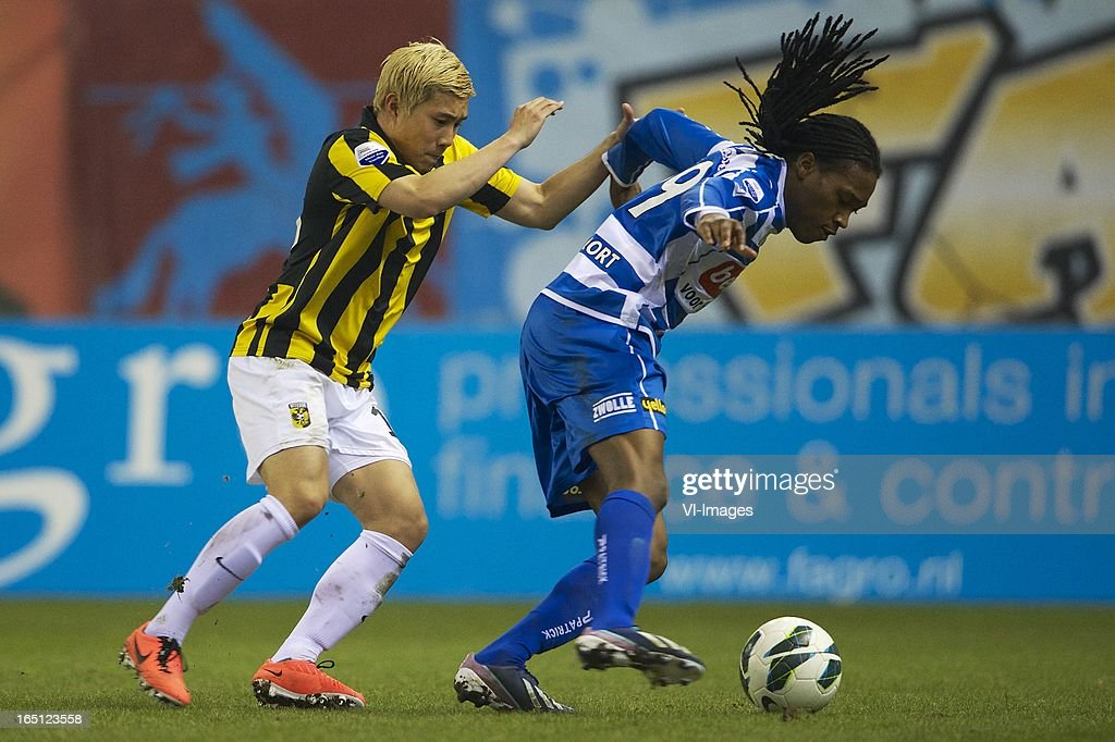 Michihiro Yasuda of Vitesse, Arsenio Valpoort of PEC Zwolle during the Dutch Eredivisie match between Vitesse Arnhem and PEC Zwolle at the Gelredome on march 31, 2013 in Arnhem, The Netherlands