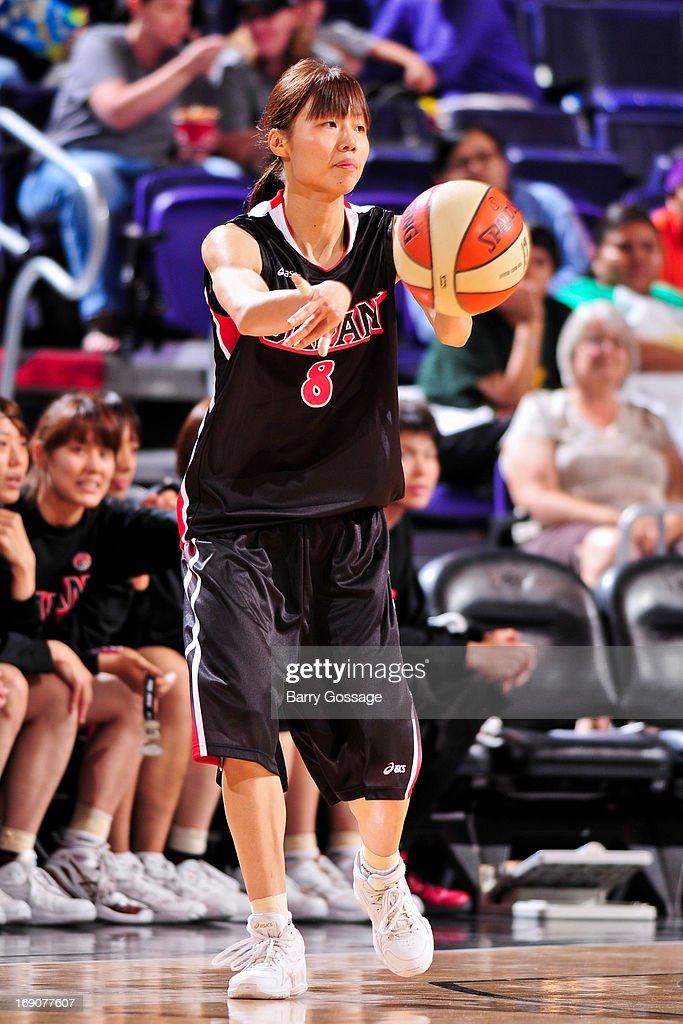 Michiko Miyamoto #8 of the Japanese National Team passes the ball against the Phoenix Mercury during a WNBA preseason game on May 19, 2013 at U.S. Airways Center in Phoenix, Arizona.
