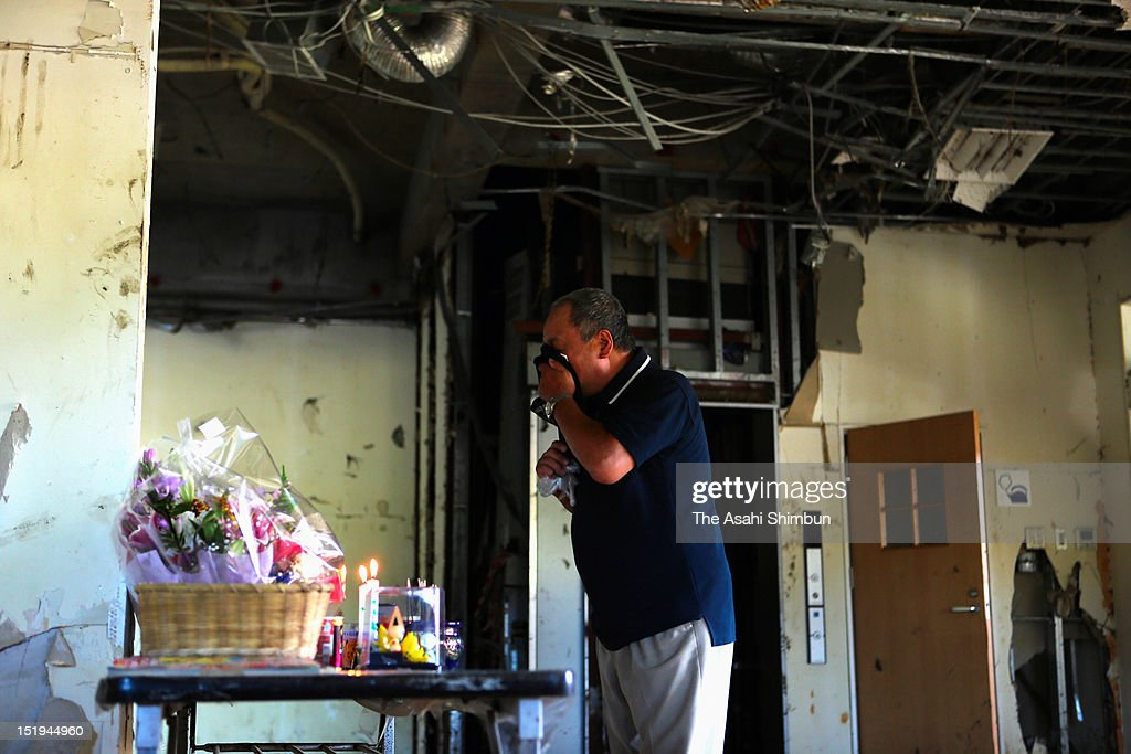 Michiyuki Kikuchi, 65, sheds tears at the ruin of the Unosumai Area Disaster Prevention Center, where he lost his daughter-in-law and a grandchild by March 2011 tsunami, on September 11, 2012 in Kamaishi, Iwate, Japan. 18 months on, still 2,814 people are missing and 340,000 people are forced to live at temporary housing.