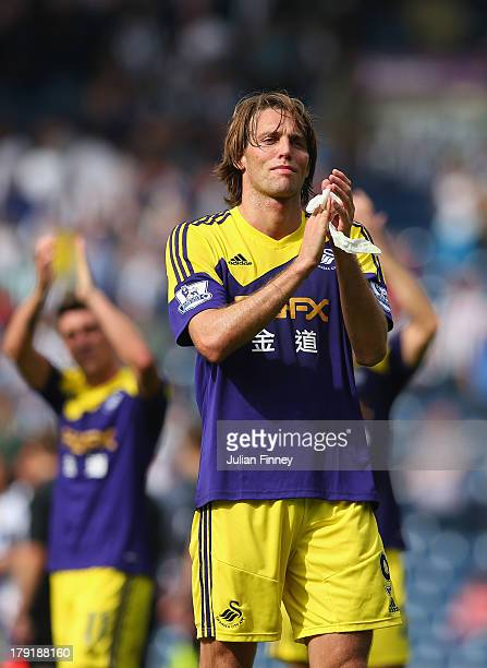 Michu of Swansea applauds the traveling fans after the Barclays Premier League match between West Bromwich Albion and Swansea City at The Hawthorns...