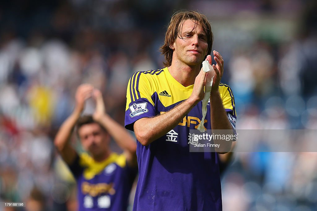 Michu of Swansea applauds the traveling fans after the Barclays Premier League match between West Bromwich Albion and Swansea City at The Hawthorns on September 01, 2013 in West Bromwich, England.