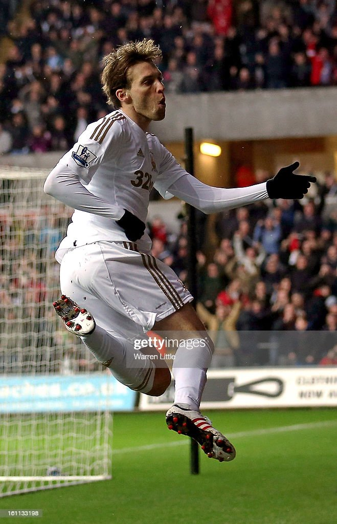 Michu of Swansea celebrates scoring the opening goal during the Premier League match between Swansea City and Queens Park Rangers at Liberty Stadium on February 9, 2013 in Swansea, Wales.