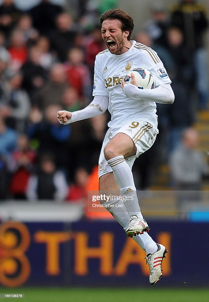 Michu of Swansea celebrates scoring their first goal during the Barclays Premier League match between Swansea City and Tottenham Hotspur at Liberty Stadium on March 30, 2013 in Swansea, Wales.