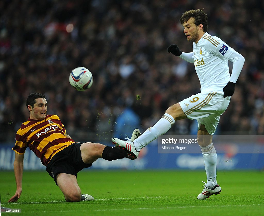 Michu of Swansea City and Carl McHugh of Bradford City compete for the ball during the Capital One Cup Final match between Bradford City and Swansea City at Wembley Stadium on February 24, 2013 in London, England.