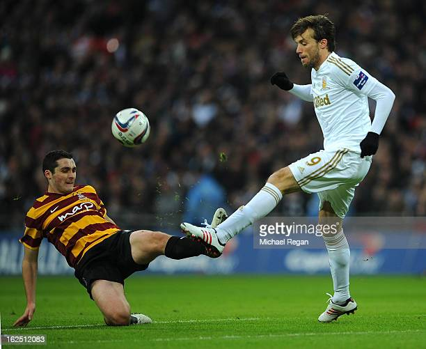 Michu of Swansea City and Carl McHugh of Bradford City compete for the ball during the Capital One Cup Final match between Bradford City and Swansea...