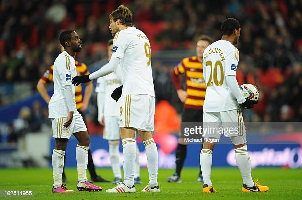 Michu of Swansea City breaks up an arguement between Nathan Dyer of Swansea City and Jonathan de Guzman of Swansea City during the Capital One Cup...